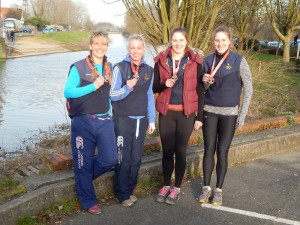 Women's 2x and 2- with their medals